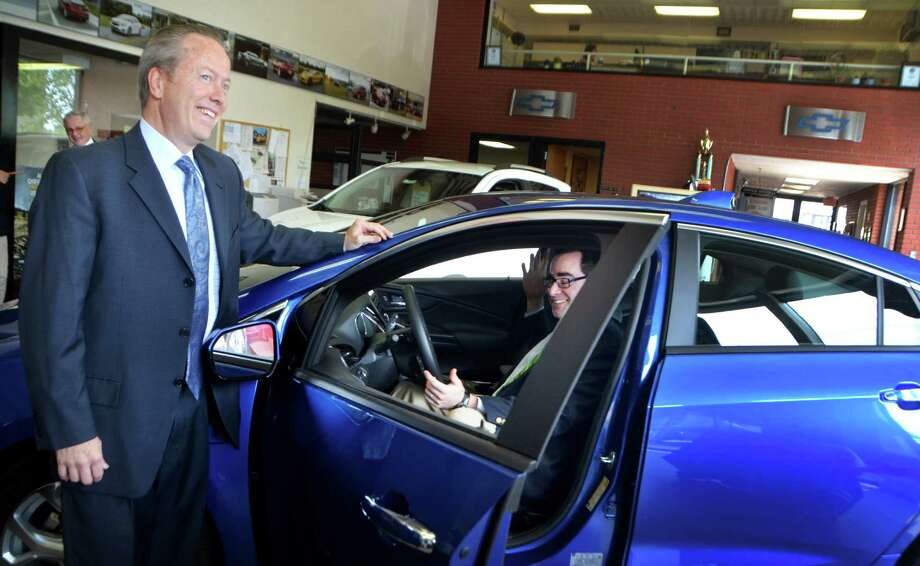 Leo E. Karl, president of Karl Chevrolet, and Commissioner of Connecticut's Department of Energy and Environmental Protection, Robert Klee, stand in front of the new 2016 Chevy Volt in New Canaan, Conn. on Tuesday, July 28, 2015. Klee and Karl gathered with other executives at Karl Chevrolet to speak about the future of the Connecticut Hydrogen and Electric Vehicle Purchase Rebate (CHEAPR) program which is designed to put more electric vehicles on the road to replace gasoline powered vehicles. Photo: Bailey Wright / For Hearst Connecticut Media / Connecticut Post Freelance