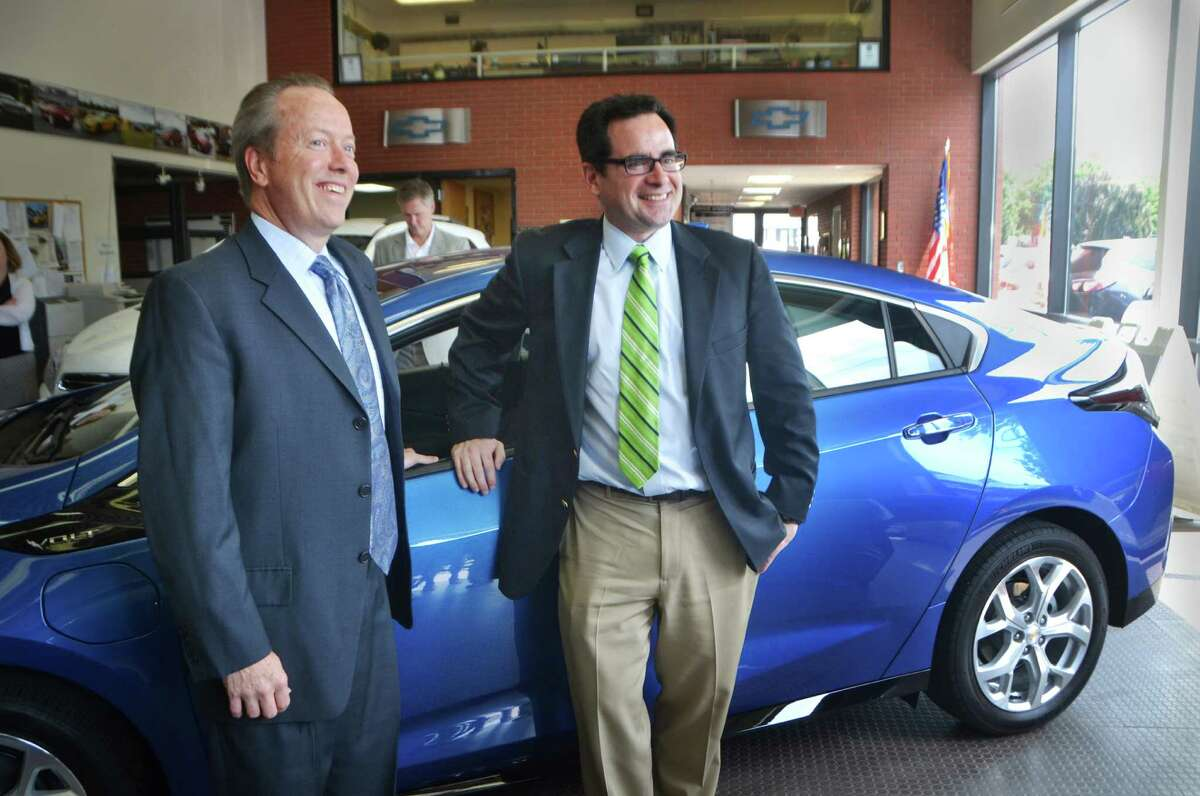 Leo E. Karl, president of Karl Chevrolet, and Commissioner of Connecticut's Department of Energy and Environmental Protection, Robert Klee, stand in front of the new 2016 Chevy Volt in New Canaan, Conn. on Tuesday, July 28, 2015. Klee and Karl gathered with other executives at Karl Chevrolet to speak about the future of the Connecticut Hydrogen and Electric Vehicle Purchase Rebate (CHEAPR) program which is designed to put more electric vehicles on the road to replace gasoline powered vehicles.