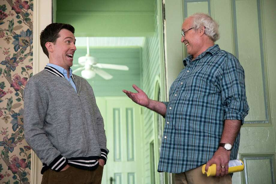 "In this image released by Warner Bros. Entertainment, Ed Helms, left, and Chevy Chase appear in a scene from ""Vacation."" In Hollywood's reboot frenzy, the movie industry has increasingly turned to reviving classic comedies. The latest attempt is ""Vacation,"" a new try at the 1983 classic National Lampoon film starring Chase. He makes a cameo in the latest ""Vacation,"" returning as Clark Griswold, but has ceded the driver's seat to his son, Rusty Griswold, played by Helms. (Hopper Stone/Warner Bros. Entertainment via AP) ORG XMIT: NYET702 Photo: Hopper Stone / Warner Bros. Entertainment"