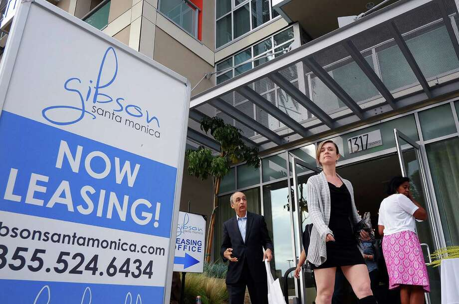 In this Wednesday, March 18, 2015 photo, visitors arrive for the grand opening of Gibson Santa Monica, a new luxury apartment complex in downtown Santa Monica, Calif. Residential rents, the biggest driver of inflation in 2015, climbed 3.5 percent in June from a year earlier, the fifth straight month with an annual gain of that size. (AP Photo/Richard Vogel) ORG XMIT: NYBZ141 Photo: Richard Vogel / AP