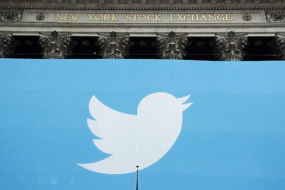 File - In this Nov. 7, 2013, file photo, a Twitter sign is draped on the facade of the New York Stock Exchange before its IPO in New York. Twitter reports quarterly financial results on Tuesday, July 28, 2015. (AP Photo/Mark Lennihan, File)