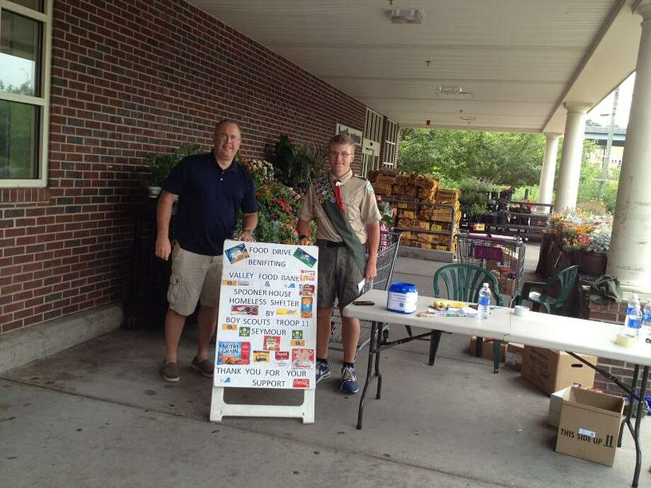 Eagle Scout candidate Andrew Zehall from Troop 11 in Seymour collecting food on July 26, 2015, at Stop & Shop, 15 Franklin Street in Seymour. Photo: Contributed / Contributed Photo / Connecticut Post
