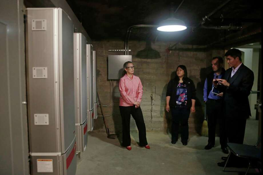 Barbara Hale (left), Barbara Lau, Charles Sheehan and Tyrone Jue of the Public Utilities Commission visit Downtown High School's electrical room last week. Photo: Lea Suzuki / Photos By Lea Suzuki / The Chronicle / ONLINE_YES
