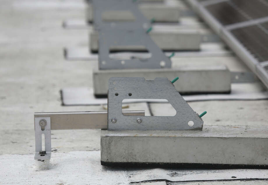 Stanchions which provide seismic restraint are seen next to the new solar array on the roof of the Downtown High School on Tuesday, July 21, 2015 in San Francisco, Calif. Photo: Lea Suzuki / The Chronicle / ONLINE_YES