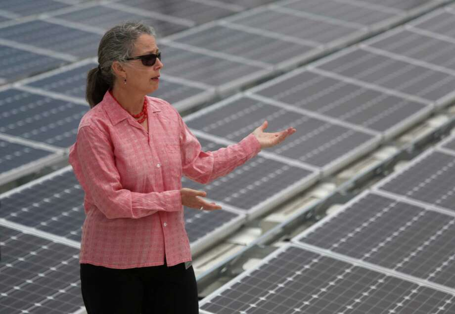 Barbara Hale, assistant general manager San Francisco Public Utilities Commission, stands next to the new solar array on the roof of the Downtown High School. Photo: Lea Suzuki / Lea Suzuki / The Chronicle / ONLINE_YES