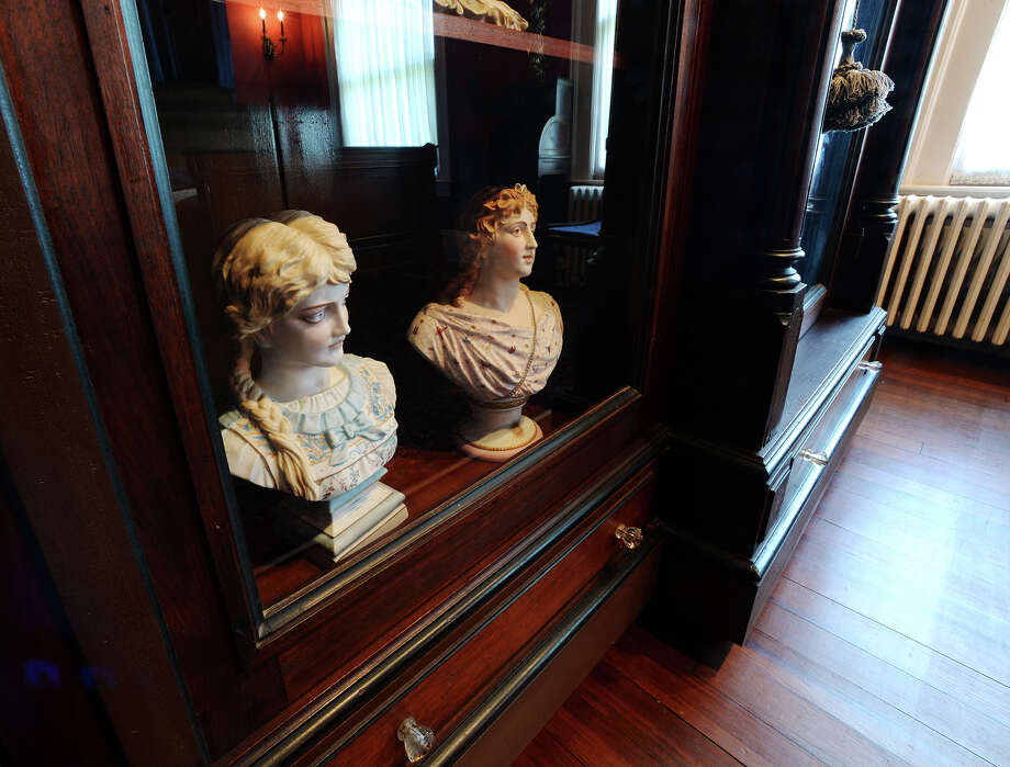 Busts are seen inside a cabinet in a bedroom of the villa on Tuesday. Photo taken Tuesday 7/28/15 Jake Daniels/The Enterprise Photo: Jake Daniels / ©2015 The Beaumont Enterprise/Jake Daniels