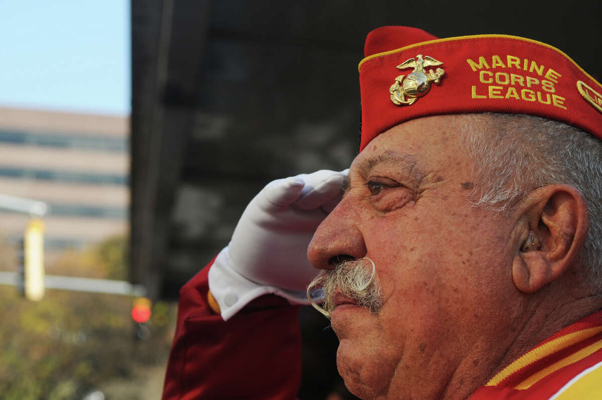 Pasquale Battinelli salutes during Stamford's Annual Veterans Day Parade from Hoyt Street to Veterans Park in Stamford, Conn., Nov. 11, 2012.