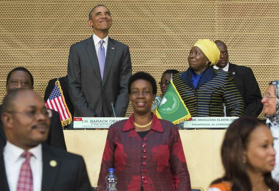 President Barack Obama, alongside African Union Chairperson Nkosazana Dlamini Zuma, right, arrives to speak about security and economic issues and U.S.-Africa relations at the African Union Headquarters in Ethopia, on Tuesday. 2015. Barack Obama arrived at African Union headquarters today, where he will become the first US president to address the 54-member continental bloc, at the end of a tour focused on corruption, rights and security. AFP PHOTO / SAUL LOEBSAUL LOEB/AFP/Getty Images Photo: SAUL LOEB, Staff / AFP
