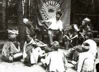 Ernest Thompson Seton enthralls local Cos Cob youth with his many Indian tales - circa 1904. The youngsters were among the earliest members of Seton's Woodcraft Indians and met at the artist and conservationist's Cos Cob estate, Wyndygoul. Seton and his Woodcraft Indians would play a major role in the establishment of the Boy Scouts of America.