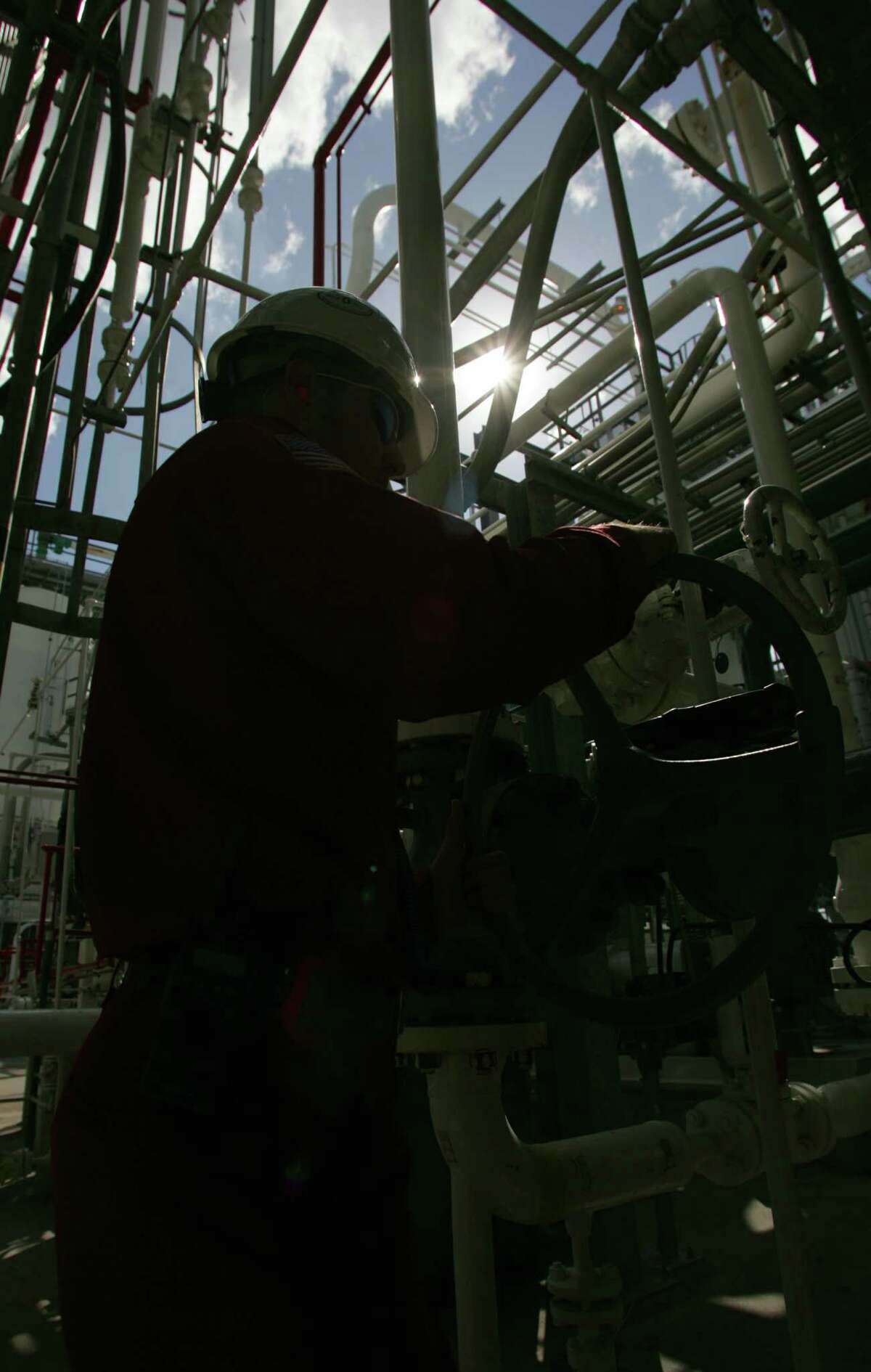 A LyondellBasell worker makes a valve adjustment in Pasadena. LyondellBasell has completed expansion of a Channelview plant.
