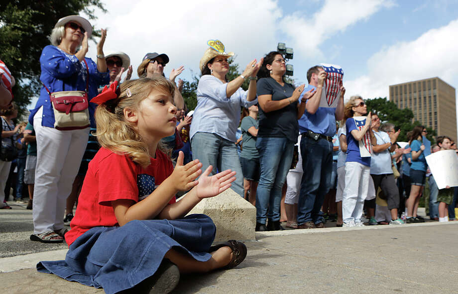 Clarissa Y., her mother didn't want to give last name, age 4 of Austin, sits with a crowd of about 130 supporters of Texas Alliance for Life, as they hold an anti-abortion rally at the Texas Capitol on Tuesday, July 28, 2015, in Austin, Texas. Photo: Bob Owen, Staff / San Antonio Express-News / ©2015 San Antonio Express-News