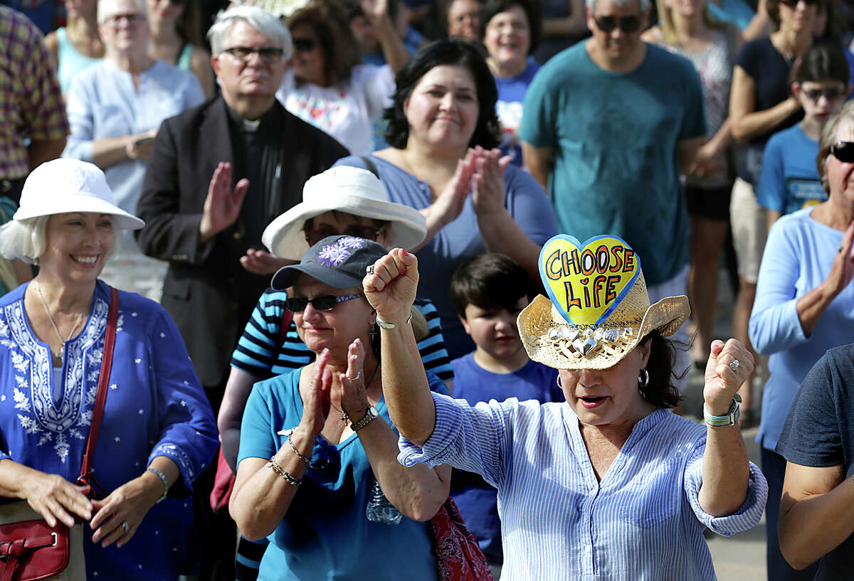 Kathy Culver, right, of Austin, pumps her fists as she and close to 130 other supporters of Texas Alliance for Life attend an anti-abortion rally at the Texas Capitol on Tuesday, July 28, 2015, in Austin, Texas.