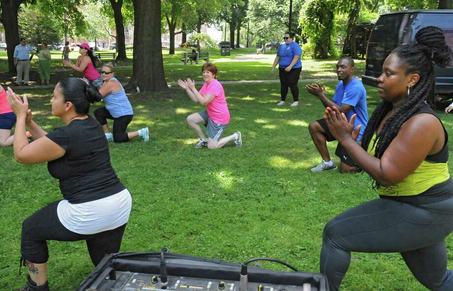 Instructor Cassandra Carter, right, leads a free Zumba class as part of Department of RecreationOs 1609 Challenge at Academy Park on Tuesday, July 28, 2015 in Albany, N.Y.  Albany Mayor Kathy Sheehan, center, also participated. (Lori Van Buren / Times Union) Photo: Lori Van Buren / 00032755A