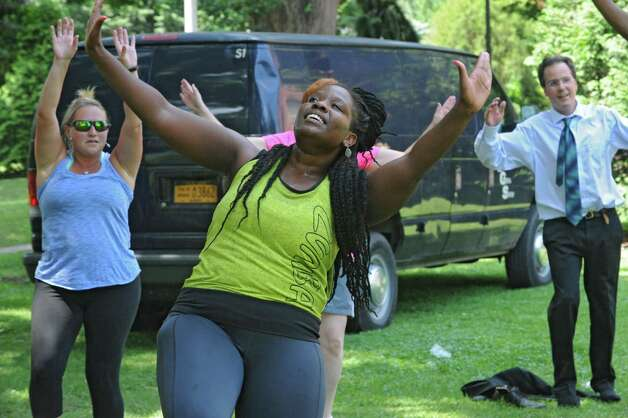 Instructor Cassandra Carter, center, leads a free Zumba class as part of Department of RecreationOs 1609 Challenge at Academy Park on Tuesday, July 28, 2015 in Albany, N.Y. (Lori Van Buren / Times Union) Photo: Lori Van Buren / 00032755A