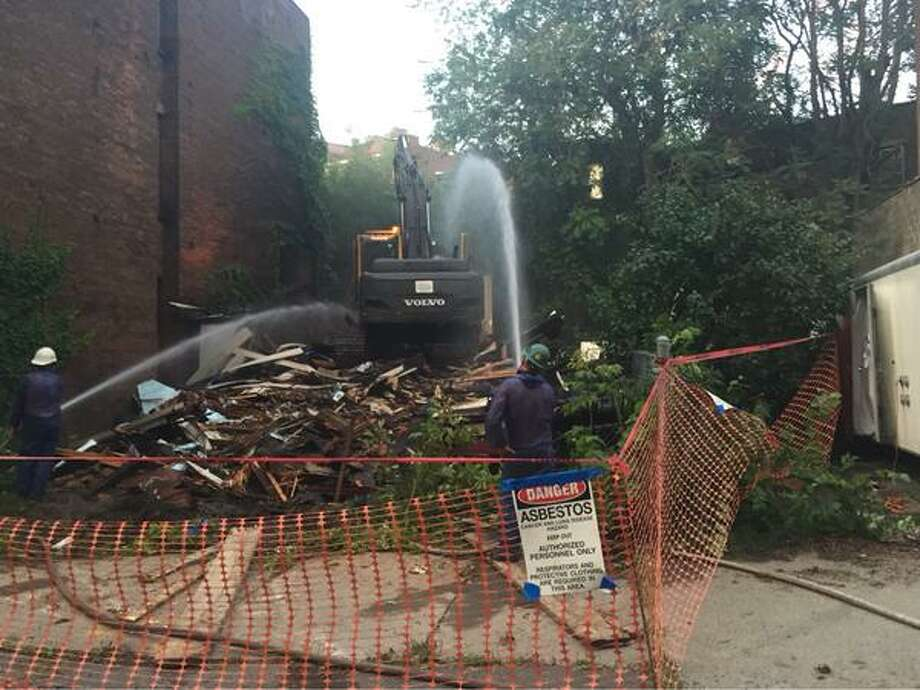 A building at 90 King St. is demolished after portions started to collapse this week. (Kenneth C. Crowe II)