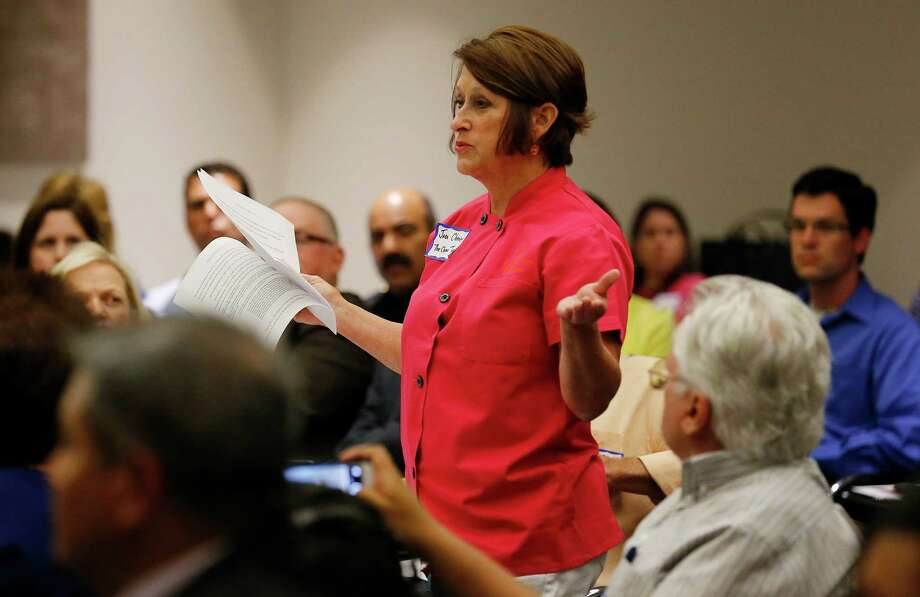 Joan Cheever of The Chow Train speaks at a summit between city officials and organizations involved with feeding the homeless at the Central Library on Tuesday, July 28, 2015. Involved citizens along with charitable organizations voiced their concerns and shared ideas with the city as to how to effectively work together to feed the needy in the city. Cheever and her organization had been in the spotlight for being issued a controversial citation while feeding the homeless at Maverick Park. (Kin Man Hui/San Antonio Express-News) Photo: Kin Man Hui, Staff / San Antonio Express-News / ©2015 San Antonio Express-News