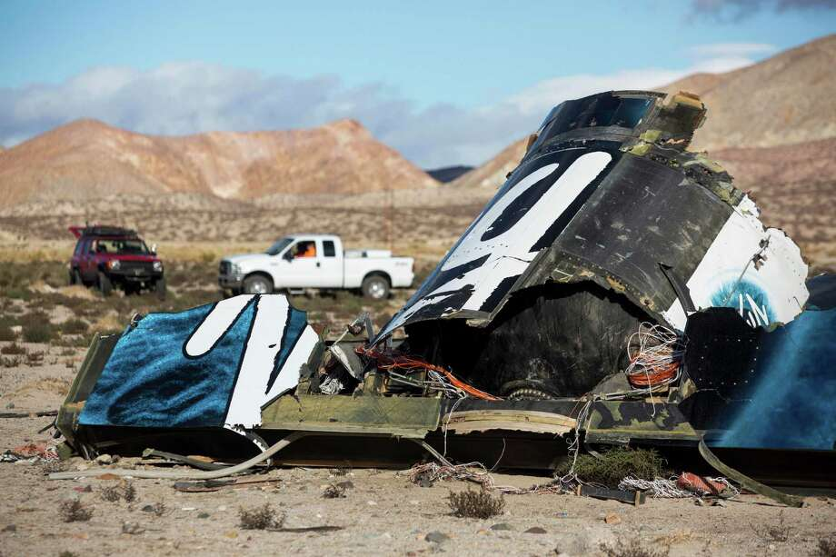 In this Nov. 1, 2014 file photo, wreckage lies near the site where a Virgin Galactic space tourism rocket, SpaceShipTwo, exploded and crashed in Mojave, Calif. Photo: Ringo H.W. Chiu /Associated Press / FR170512 AP