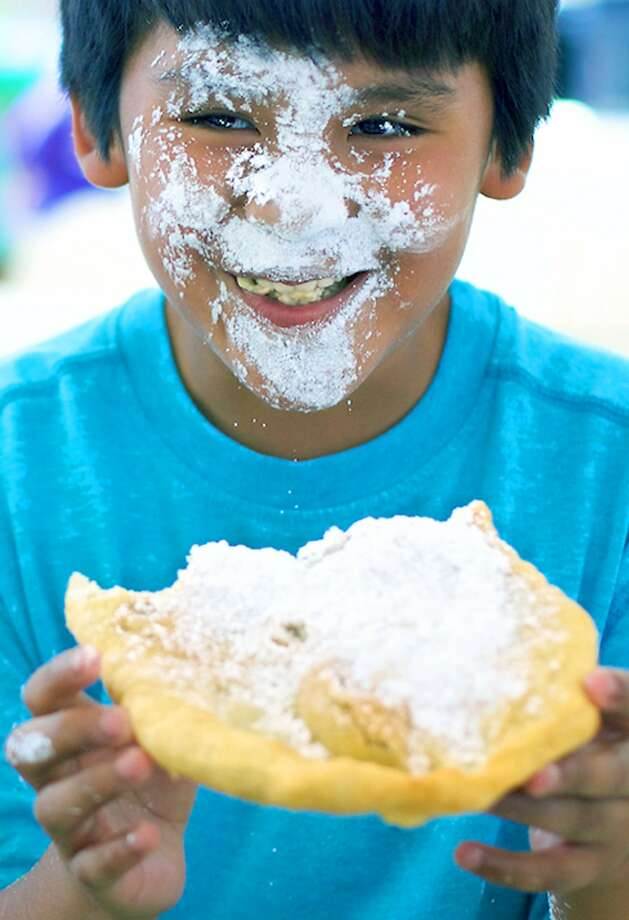 Grin and bear it  Nate Tietjen, 10, of New Milford makes a happy mess with fried dough straight from the Rotary Club's concession van during the Greater New Milford Chamber of Commerce's annual Village Fair Days on the Village Green. Thousands attended the two-day summer festival July 24-15 under sunny skies. For more photos, visit Pages S6-7 and check updates at www.newmifordspectrum.com. July 24, 2015 Photo: Trish Haldin