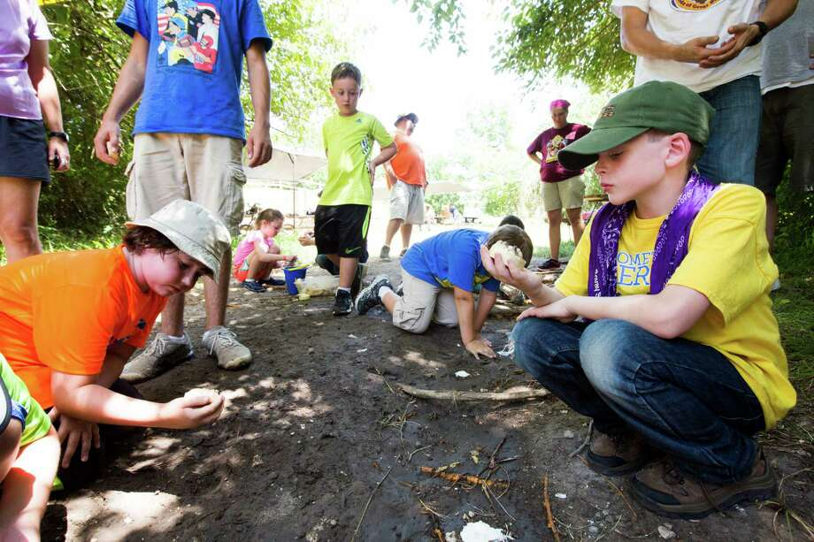 While area church leaders have mixed reactions to a decision by the Boy Scouts to allow openly gay troop leaders, Cub Scouts enjoy activities Tuesday, July 28 at the McNair Cub Scout Adventure Camp in Navasota. Photo: Marie D. De Jesus, Staff / © 2015 Houston Chronicle