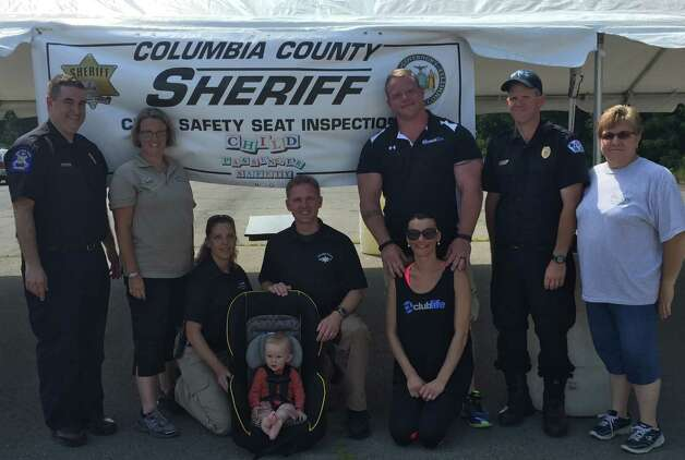 Child passenger safety technicians from the Columbia County Sheriff?s Office and health department held a seat inspection in Kinderhook on July 18. Also supporting the effort were the Valatie Rescue Squad, owners and staff of Club Life and owners and staff of Cantele Tent Rentals for their tent donation. (Submitted photo)