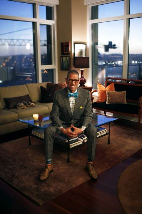 """Andrew Freeman sits within his condo on the 22nd floor of the Soma Grand.  Freeman is the owner of Andrew Freeman & Co., a restaurant and hospitality consulting business in San Francisco.  He will be appearing on an upcoming episode of """"Million Dollar Listing San Francisco."""" Photo: Cameron Robert, The Chronicle"""