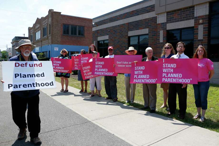 Mike Schweigert, 66, of Guilderland walks by supporters during a rally to defund Planned Parenthood outside the State Street location on Tuesday, July 28, 2015, in Schenectady, N.Y. (Olivia Nadel/ Special to the Times Union) Photo: ON / 00032777A