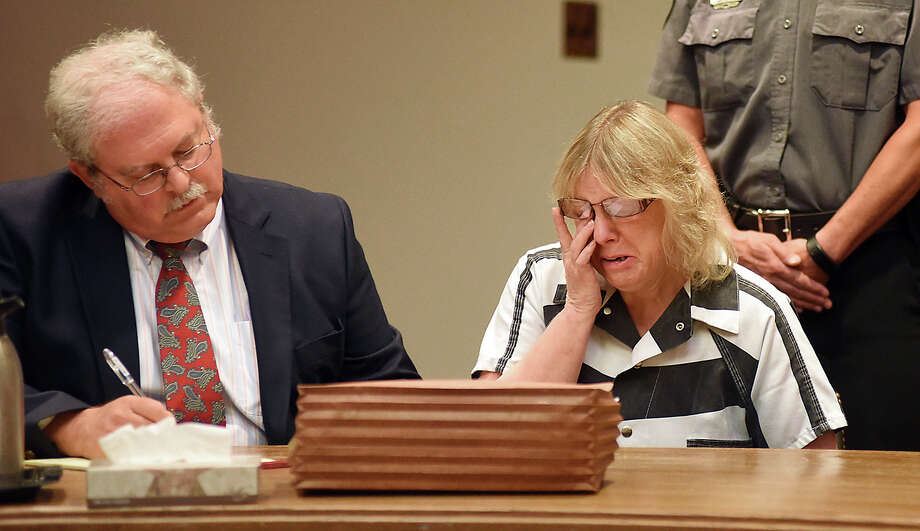 Joyce Mitchell cries as she sits with her attorney Stephen Johnston in court on Tuesday July 28, 2015 in Plattsburgh, N.Y.  Mitchell, an instructor in the tailor shop at the Clinton Correctional Facility, pleaded guilty to charges of aiding two inmates convicted of murder by smuggling hacksaw blades and other tools to the pair, who broke out and spent three weeks on the run in June. She faces a sentence of 2 1/3 to 7 years in prison under terms of a plea deal with prosecutors.  (Rob Fountain/The Press-Republican via AP, Pool)  ORG XMIT: NYPLA102 Photo: Rob Fountain / POOL The Press-Republican