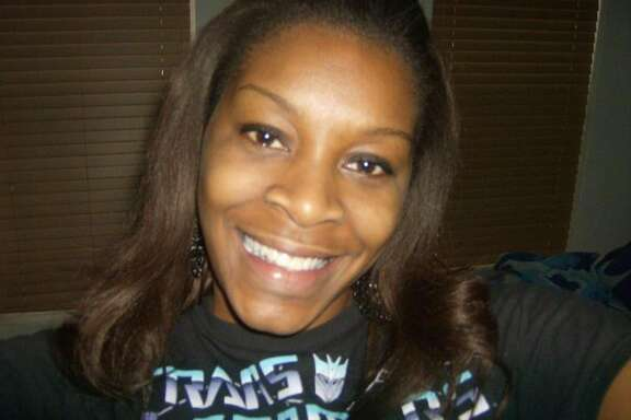 FILE - In this undated photo provided by the Bland family, Sandra Bland poses for a photo. Bland, a black 28-year-old from suburban Chicago, was found dead in jail on July 13, 2015. Texas authorities have said Bland hanged herself with a garbage bag, a finding that her family disputes. She was in custody after a traffic stop for failing to use a turn signal escalated into a physical confrontation with a white state trooper. (Courtesy of Bland family, File)