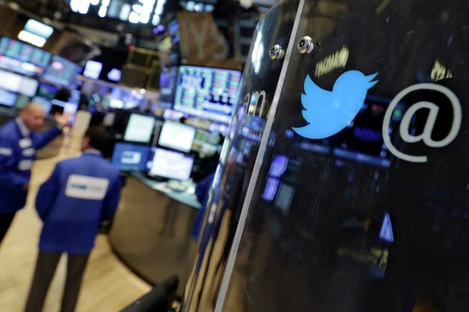 Twitter's logo adorns a phone post on the floor of the New York Stock Exchange. Photo: Richard Drew, STF / AP