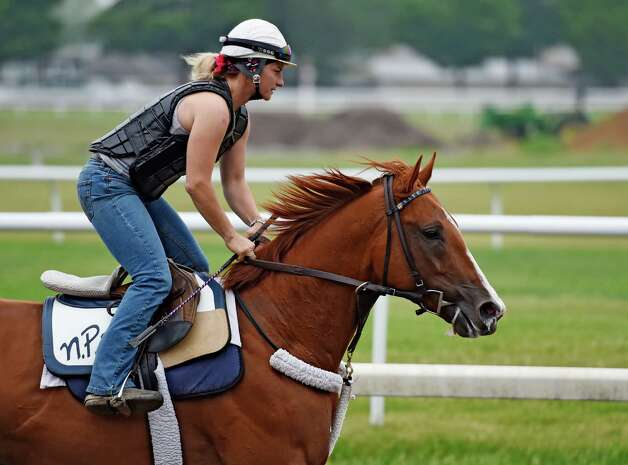 Belmont Stakes hopeful Frammento with exercise rider Heather Stark aboard out for a long gallop on the Oklahoma Training Center track Thursday morning May 28, 2015 in Saratoga Springs, N.Y.  (Skip Dickstein/Times Union) Photo: SKIP DICKSTEIN / 00032045A