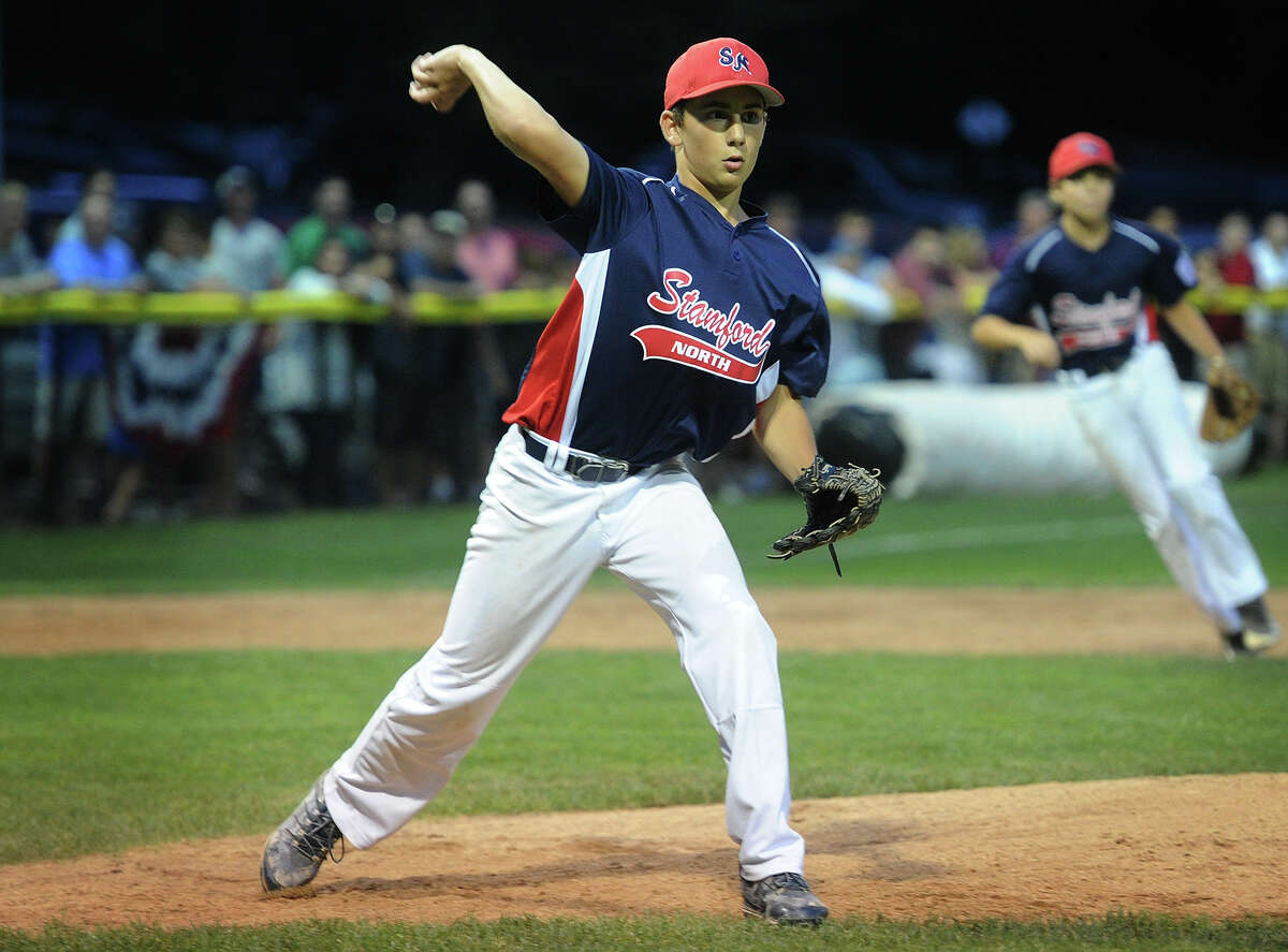 Stamford North starting pitcher Jay Lockwood fields his position making a play to first during the Little League Division 1 championship in Stamford, Conn. on Sunday, July 26, 2015. Stamford North defeated Fairfield American 5-4 in seven innings.