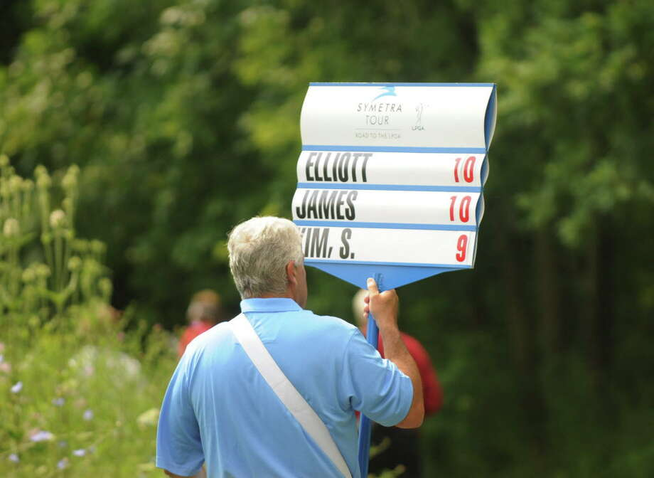 A scorekeeper walks to the next hole during the final round of the Fuccillo Kia Championship at Capital Hills on Sunday, July 26, 2015, in Albany, N.Y. (Olivia Nadel/ Special to the Times Union) Photo: ON / 00031823C