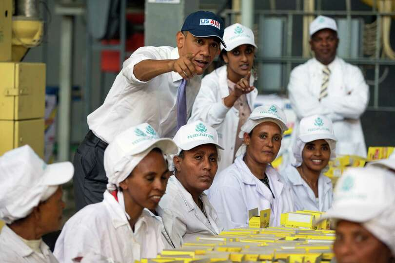 U.S. President Barack Obama talks with workers during a tour of Faffa Food, Tuesday, July 28, 2015,