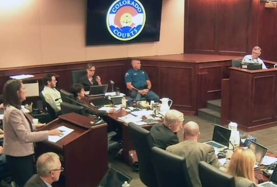 In this image made from Colorado Judicial Department video, defense attorney Tamara Brady, left, questions Robert Holmes, top right, the father of James Holmes, background left, during the sentencing phase of the Colorado theater shooting trial in Centennial, Colo., on Tuesday, July 28, 2015. (Colorado Judicial Department via AP, Pool) Photo: POOL / POOL Colorado Judicial Departmen