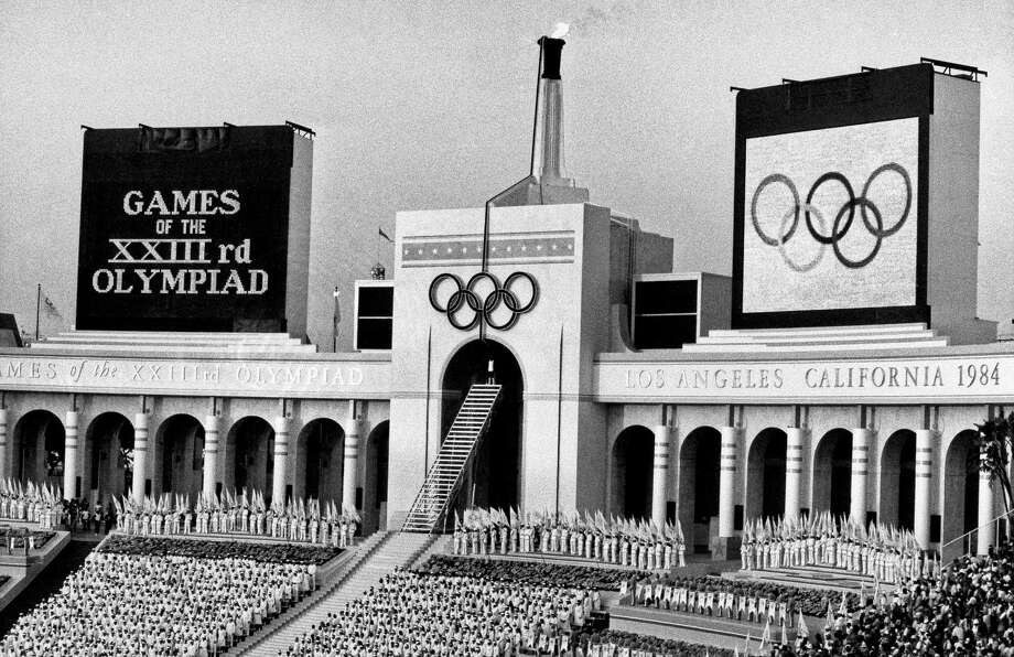 FILE - In this July 28, 1984, file photo, the Olympic flame is flanked by a scoreboard signifying the formal opening of the XXIII Olympiad after it was lit by Rafer Johnson during the opening ceremonies in the Los Angeles Memorial Coliseum. Embarrassing as it was, the U.S. Olympic Committee won't necessarily be remembered for its ungainly dumping of Boston as a bid city for the 2024 Olympics. The USOC has seven weeks to get another city on board _ and it could be Los Angeles. (AP Photo/Eric Risberg, File) ORG XMIT: NY161 Photo: Eric Risberg / AP