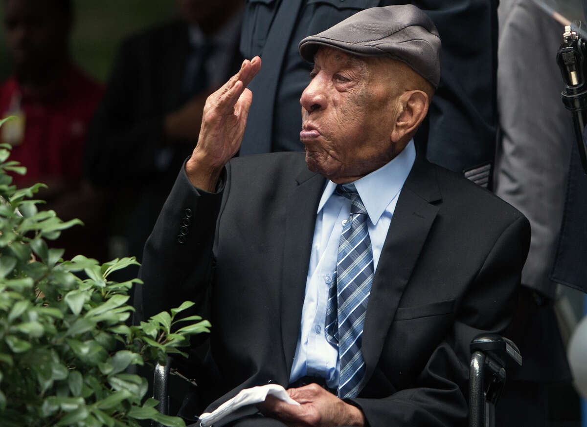 Edward A. Thomas salutes during a ceremony naming the Houston Police Headquarters after him, Monday, July 27, 2015, in Houston. The building was named in his honor after his 63 years of exemplary service and dedication to the department.