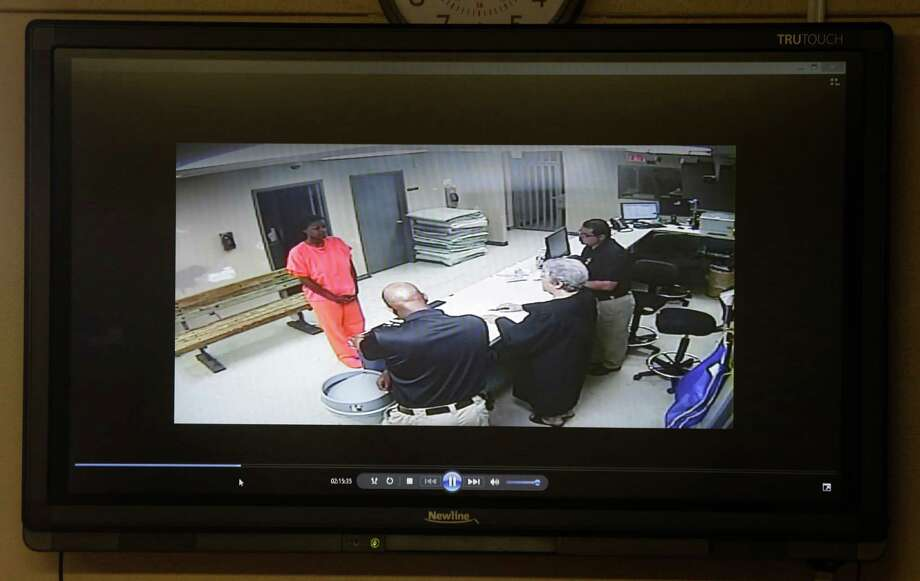 A video of Sandra Bland going through magistration in the Waller County Jail is shown during a media conference at the Waller County Courthouse Tuesday, July 24, 2015 in Hempstead. Photo: Melissa Phillip, Houston Chronicle / © 2015 Houston Chronicle