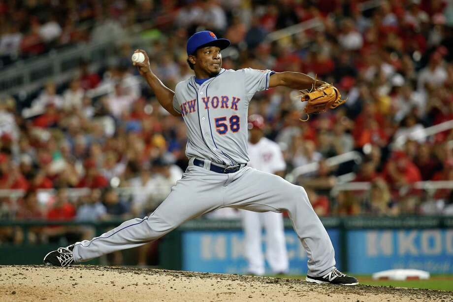 Jenrry Mejia makes an appearance for the Mets on July 21 in a season shortened to seven appearances. Photo: Rob Carr, Staff / 2015 Getty Images
