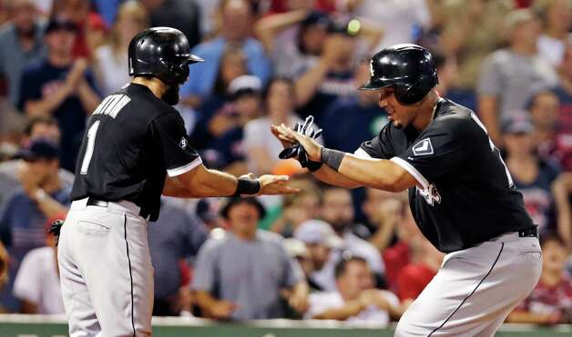 Chicago White Sox's Jose Abreu, right, is congratulated by teammate Adam Eaton after his two run home run off Boston Red Sox starting pitcher Wade Miley during the sixth inning of a baseball game at Fenway Park in Boston, Tuesday, July 28, 2015. (AP Photo/Charles Krupa) ORG XMIT: MACK119 Photo: Charles Krupa / AP