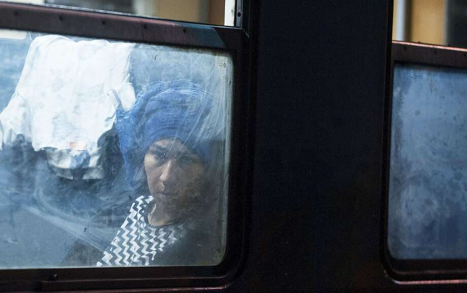 A migrant woman sits in a coach at a train headed to Serbia in the town of Gevgelija on July 27, 2015, on the Macedonian-Greek border. The migrants, among them children and elderly people are trying to cross Macedonia and Serbia and enter the EU via Hungary. Hungarian authorities started building a fence along the country's border with Serbia earlier this week to halt the migrant influx. Photo: Robert Atanasovski, AFP / Getty Images