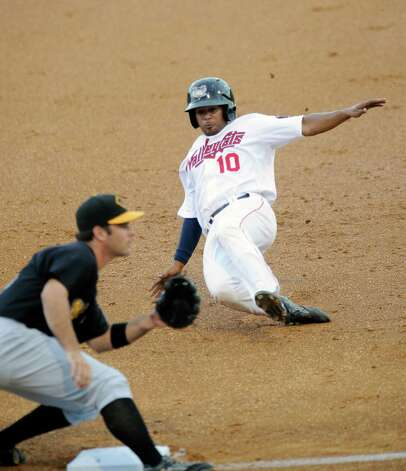 Tri-City ValleyCats Edwin Medina (10) slides under the tag of West Virginia Black Bears third baseman Daniel Arribas during their baseball game in Troy, N.Y., Tuesday, July 28, 2015. (Hans Pennink / Special to the Times Union) ORG XMIT: HP104 Photo: Hans Pennink / 00032715A