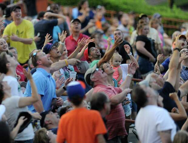 Tri-City ValleyCats fans try to catch T-shirts during a baseball game against the West Virginia Black Bears in Troy, N.Y., Tuesday, July 28, 2015. (Hans Pennink / Special to the Times Union) ORG XMIT: HP112 Photo: Hans Pennink / 00032715A