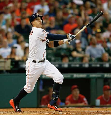 The Astros' Carlos Correa connects for his ninth home run of the season, most among American League shortstops despite the rookie's belated arrival on the major league scene. Photo: Bob Levey, Photographer / ©2015 Bob Levey