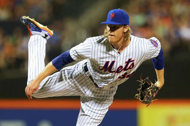 NEW YORK, NY - JULY 28:  Noah Syndergaard #34 of the New York Mets delivers a pitch against the San Diego Padres at Citi Field on July 28, 2015 in Flushing neighborhood of the Queens borough of New York City. Mets defetaed the Padres 4-0.  (Photo by Mike Stobe/Getty Images) ORG XMIT: 538587575 Photo: Mike Stobe / 2015 Getty Images