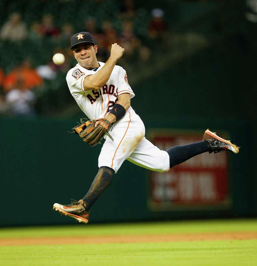 In addition to three hits, five RBIs and some nifty baserunning, Jose Altuve threw in a slick fielding play to retire the Angels' Daniel Robertson in the eighth. Photo: Bob Levey, Photographer / ©2015 Bob Levey