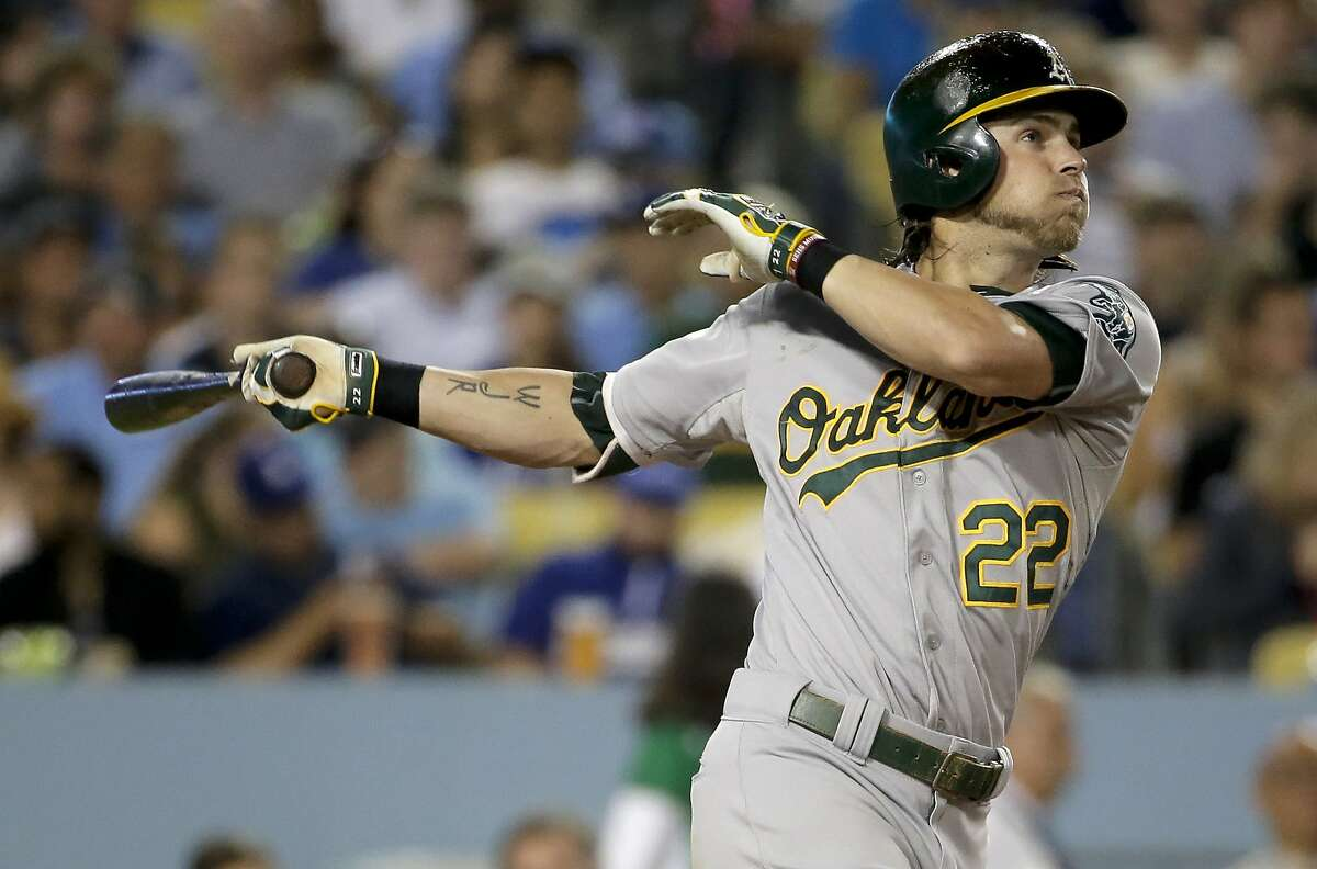 Oakland Athletics' Josh Reddick watches his home run against the Los Angeles Dodgers during the seventh inning of a baseball game in Los Angeles, Tuesday, July 28, 2015. (AP Photo/Chris Carlson)