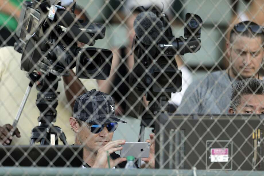 Eric Byrnes takes a photo of the screen before the game as the San Rafael Pacifics became the first professional baseball team to have balls and strikes determined by a computer, during their game against the Vallejo Admirals at Albert Park in San Rafael, Calif., on Tuesday, July 28, 2015. The called strikes and balls were announced by Eric Byrnes to benefit the Pat Tillman Foundation. Photo: Carlos Avila Gonzalez, The Chronicle