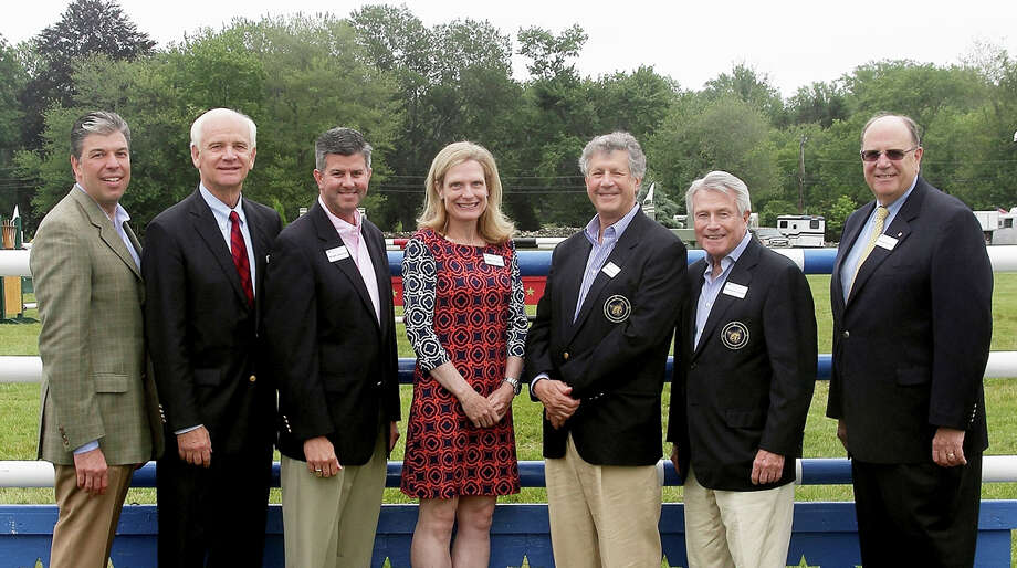 Among those on hand for the Bridgeport Hospital Foundation reception at the Fairfield County Hunt Club Horse Show were, from left, Steve Jakab, foundation president; Newman Marsilius, hospital board of directors chairman; William M. Jennings, hospital president and CEO; Lesley O'Connell, Dr. Robert Stanton and Raymond Condon, foundation board members, and Ron DeFeo, foundation board chairman. Photo: Contributed / Contributed Photo / Westport News