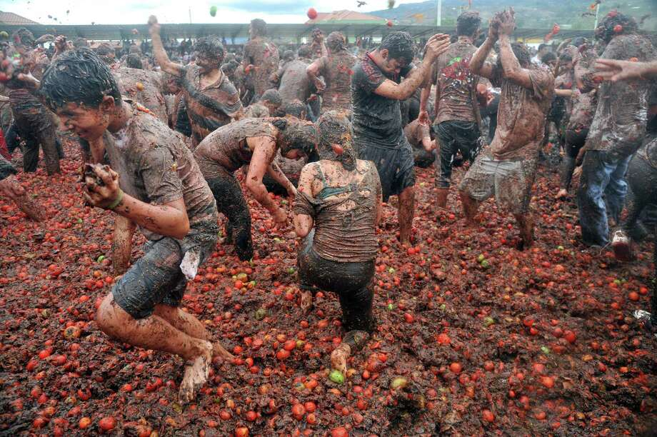 La Tomatina:People from all over gather in Buñol, Spain to throw tomatoes at each other. This odd event started as a street fight among teenagers and is now the world's biggest tomato fight. It takes place in Bunyol, Spain, and after an hour the streets get so messy they have to be hosed down by the fire department. La Tomatina is just one of the few unusual events that take place around the world. Keep going to see more odd traditions and festivities. Photo: GUILLERMO LEGARIA, Getty Images / AFP