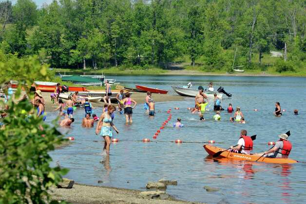 Children and adults enjoy the water at Thompson's Lake State Park on Tuesday, July 28, 2015, in  New Scotland, N.Y.   (Paul Buckowski / Times Union) Photo: PAUL BUCKOWSKI / 00032803A